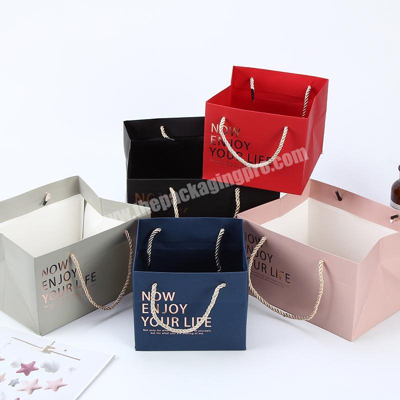Manufacturer Wholesale TOP Quality OEM Custom Pink Matte Paper Present Bag Eco-Friendly Bags With Ropes Handles