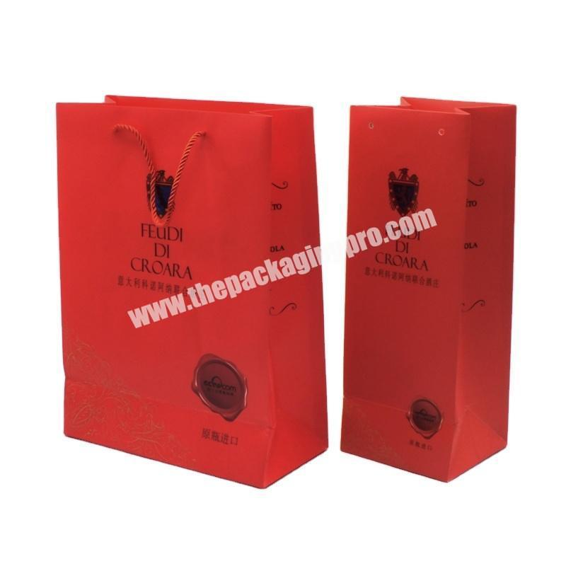 Manufacturer 2020 Popular factory new customized art paper glittering red paper handle bag for gift clothes packaging paper bag