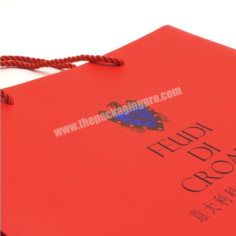 Shop 2020 Popular factory new customized art paper glittering red paper handle bag for gift clothes packaging paper bag