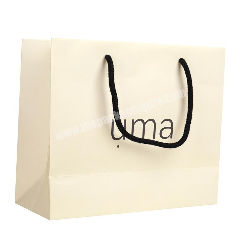 Simple style beige 250g lamination ivory paper packaging bag popular for garments 2019