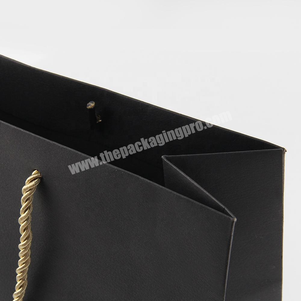 Manufacturer black matte paper tote packing bags for jeans clothing