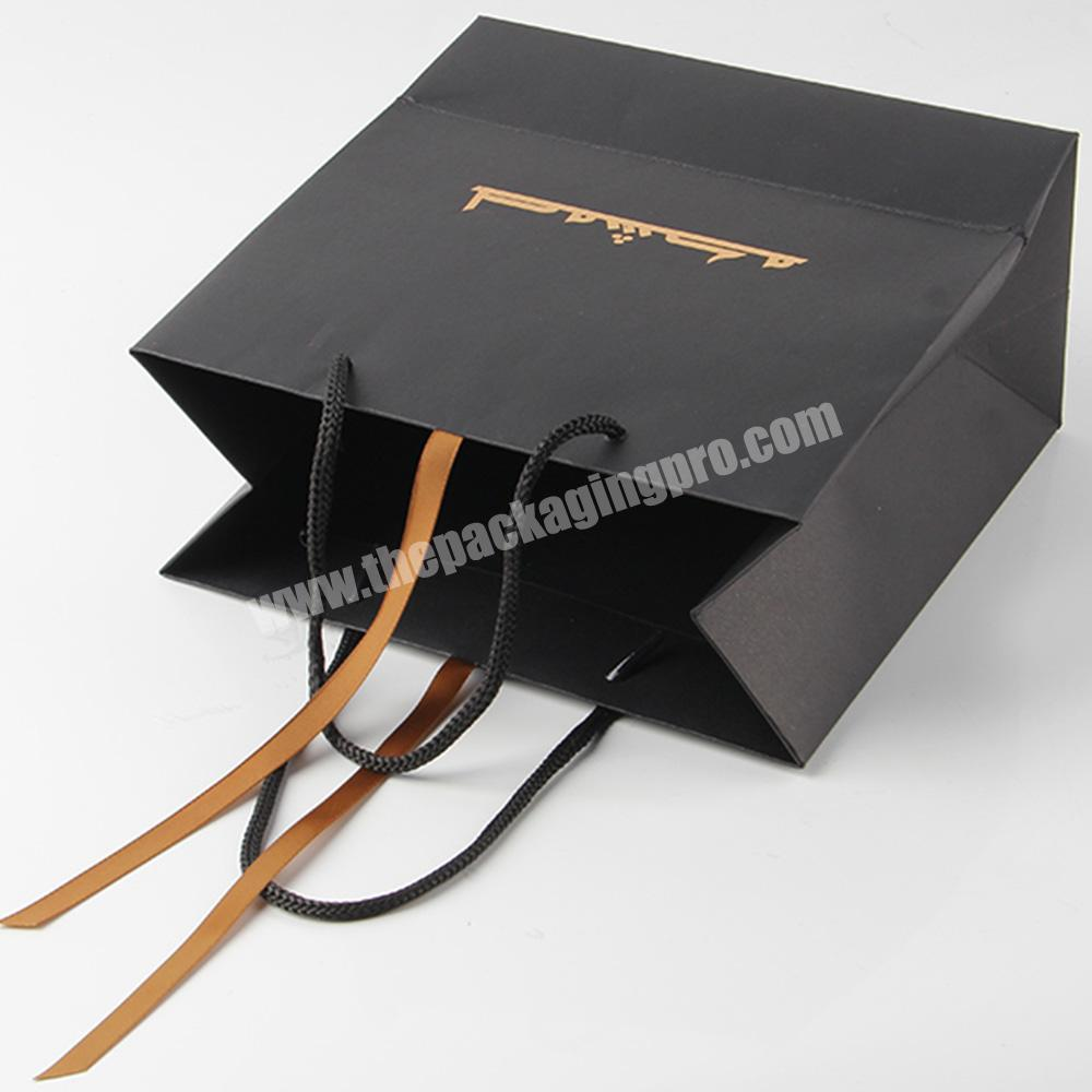 Factory cheap custom printed luxury black paper bag with ribbon