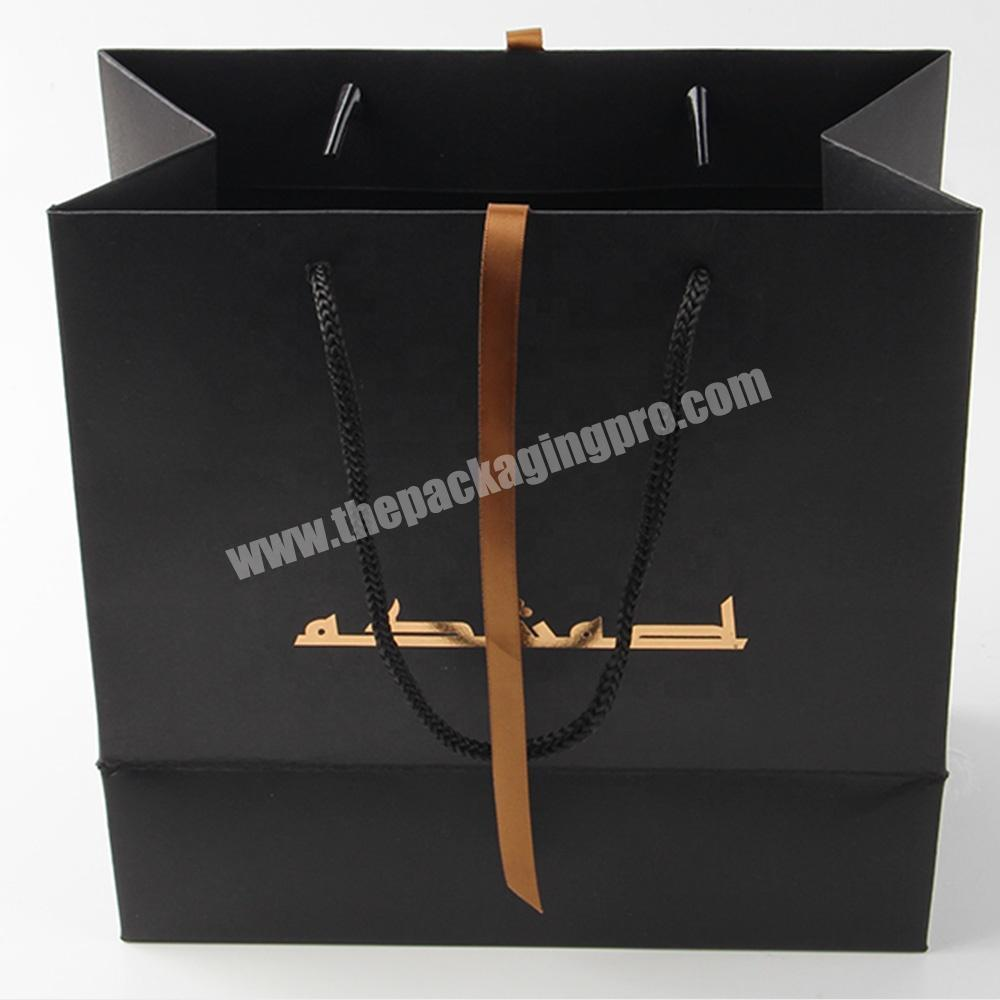 Supplier cheap custom printed luxury black paper bag with ribbon