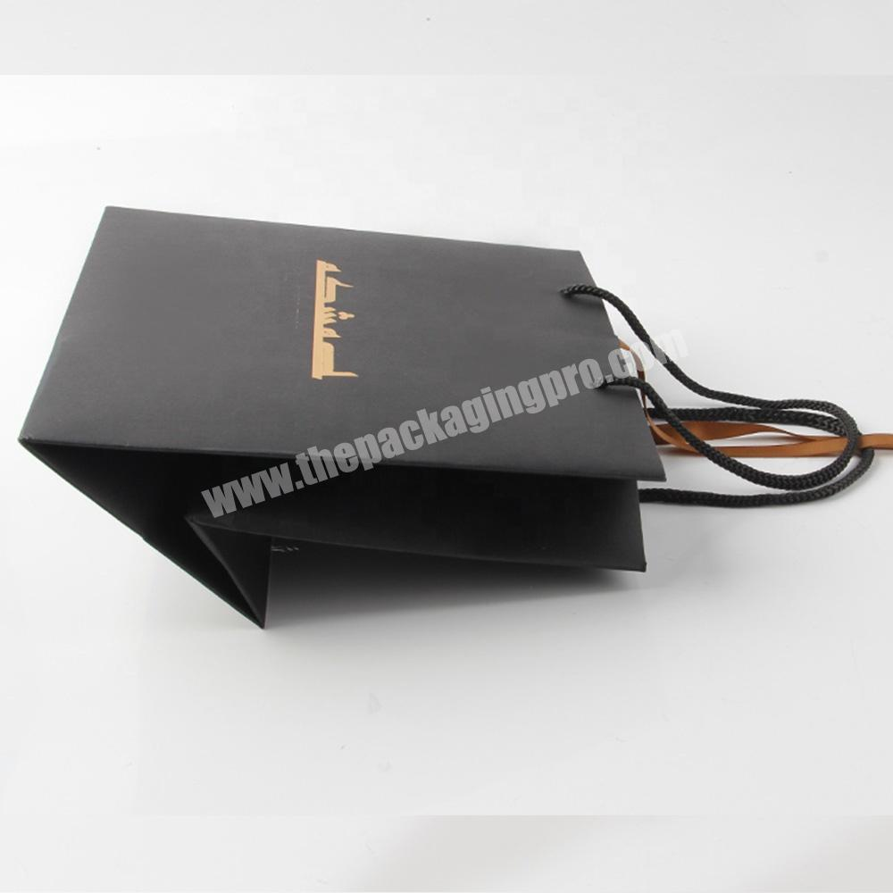 Wholesale cheap custom printed luxury black paper bag with ribbon