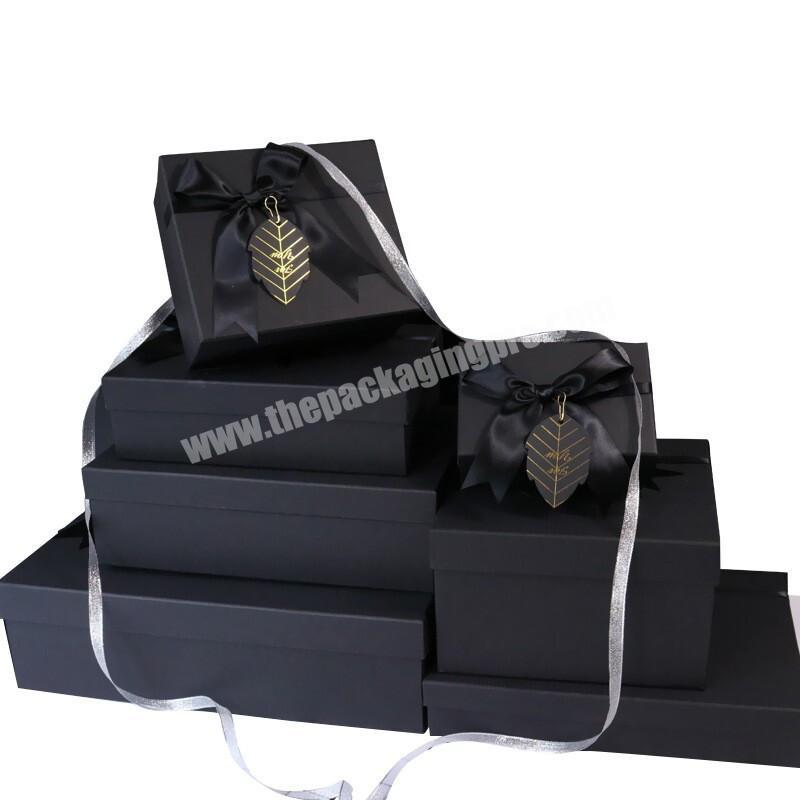 China Top Supplier Personalised Logo Printed Side Bow Customized Size Black Packed Box With Tag