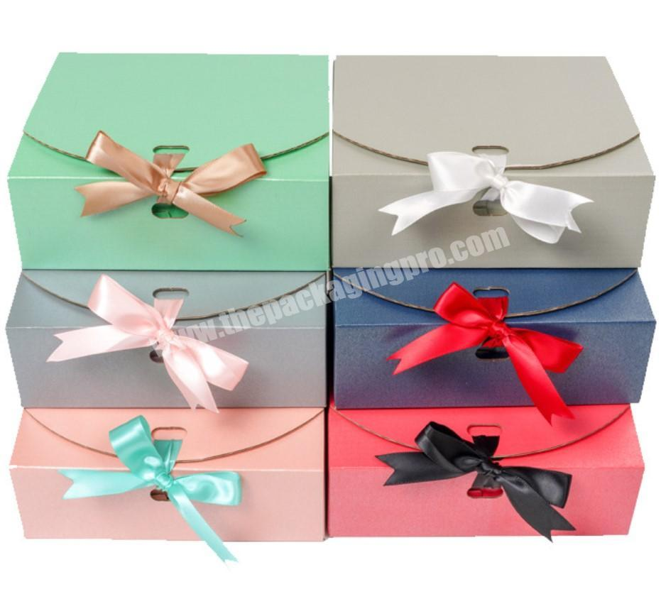 collapsible and foldable quick dispatch corrugated paper box with ribbon