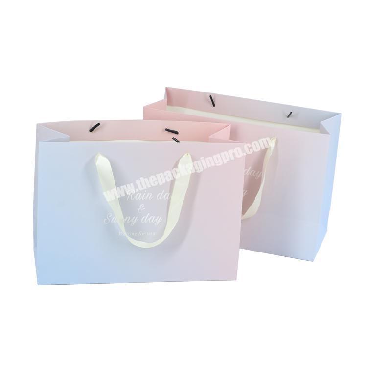 Custom CMYK matt embossed pink cardboard paper bag for gift