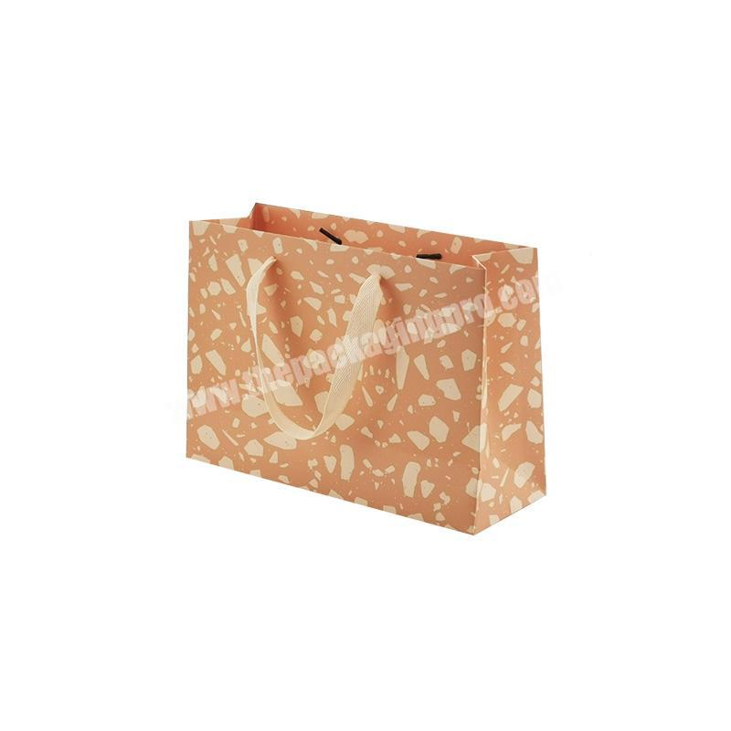 Custom handles design high quality packing paper gift bags wholesale