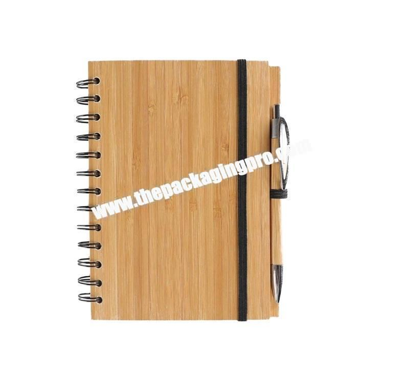 Custom Hot Sale Eco-friendy Gold Logo Wooden Bamboo Cover Spiral Ring Binding Notebook Wood Diary With Ball Pen Holder For Gift