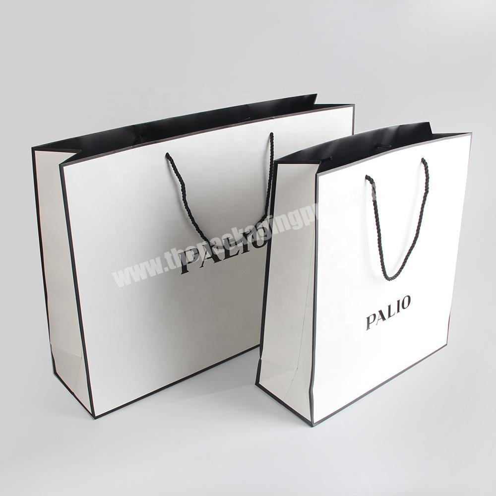 Wholesale custom logo fashion advertising paper bag rope handle