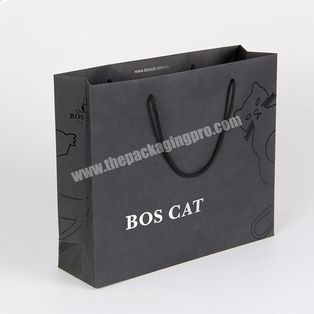 Wholesale custom logo large standard size paper shopping bag for suits