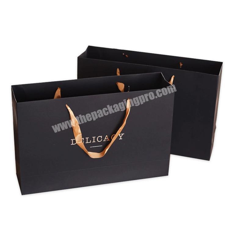 Custom luxury black art paper gift bag with UV dot logo printing