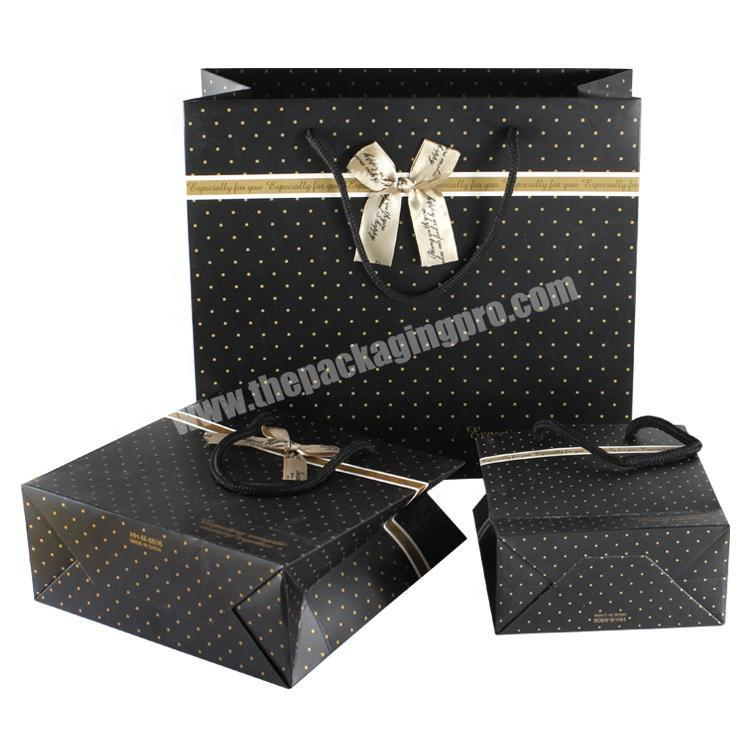 Custom printed fashional spotted uv black pasting bowknot gift paper shop bag