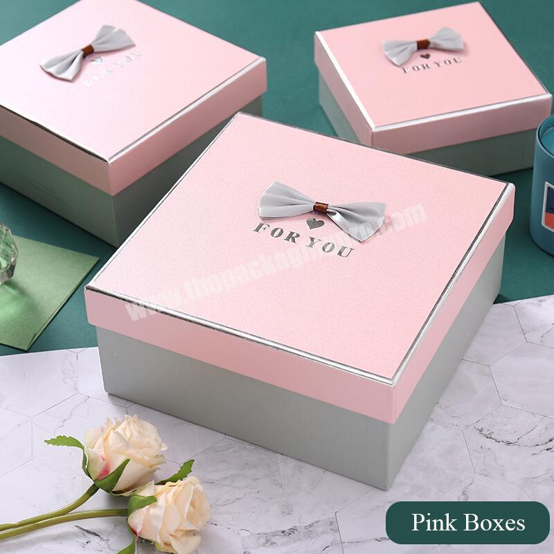 Supplier Customization gift size hot stamping pink color essential oil boxes pack silver plating packing perfume boxes with Bow