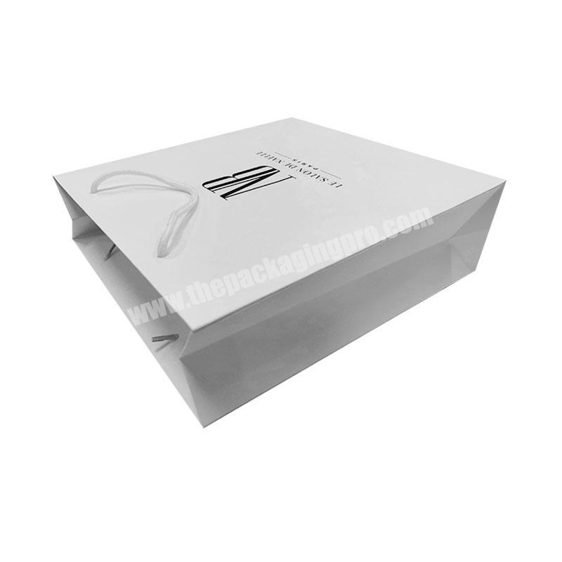 Customize bulk white luxury clothing packaging gift paper bags wholesale