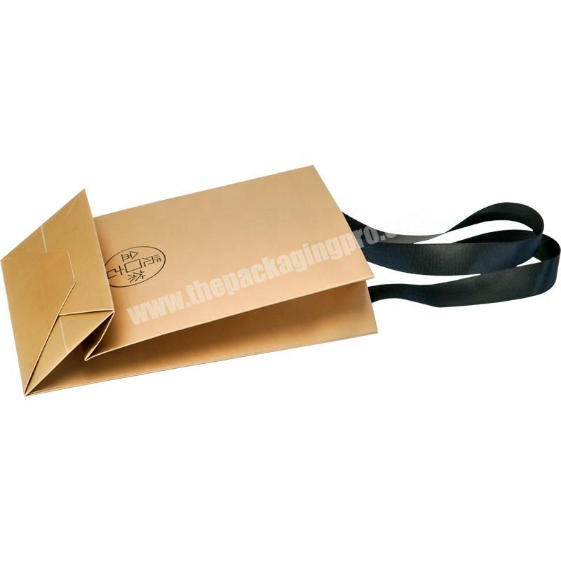 Dongming beautiful gold foldable tea white cardboard paperbag with hot stamping