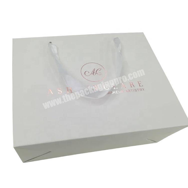 Embossing custom rose gold foil logo printed paper makeup gift bag