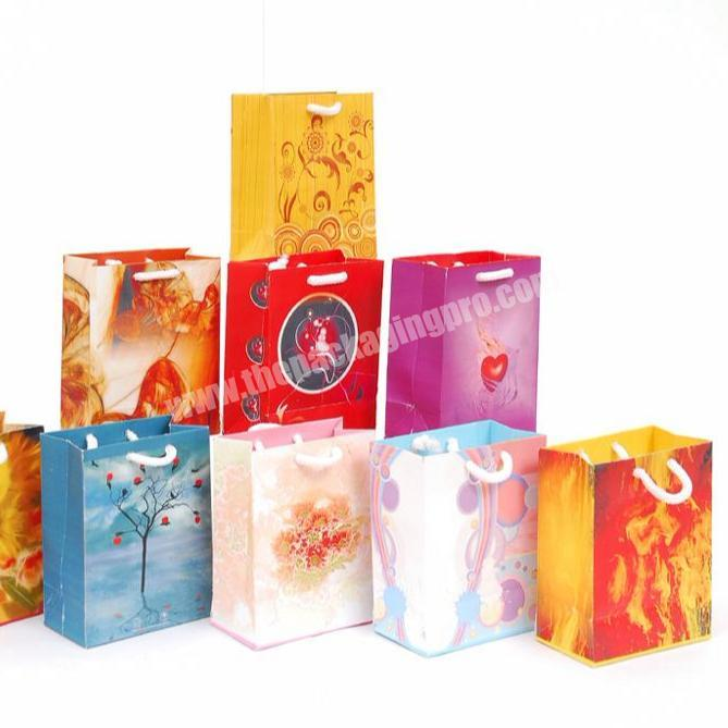 Factory Price Eco-friendly high quality coated paper shopping bag sample design