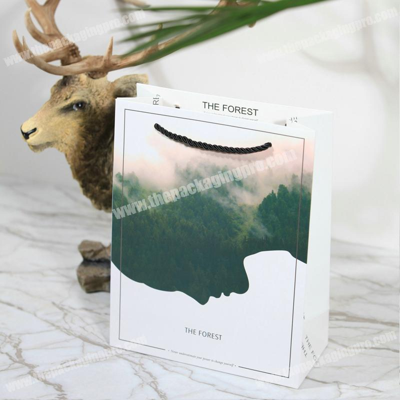 High quality low price high grade forest image custom picture printed packaging white paper gift bag