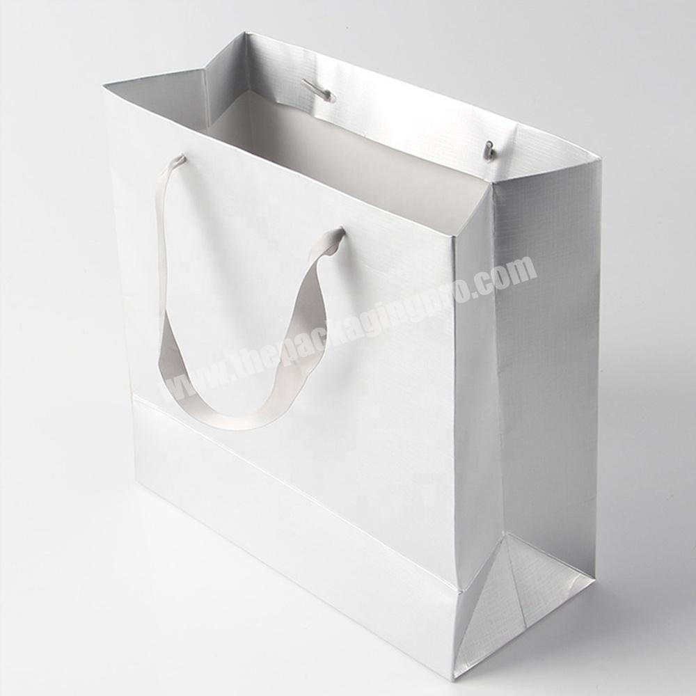 Custom hot glossy white jewelry paper bags for wedding dress