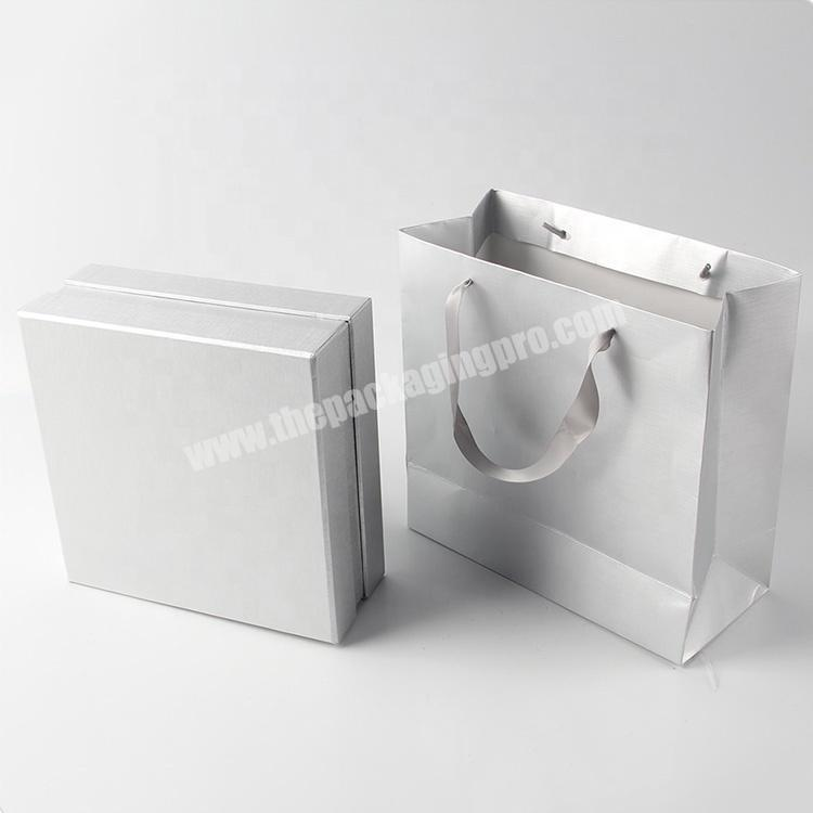 Supplier hot glossy white jewelry paper bags for wedding dress