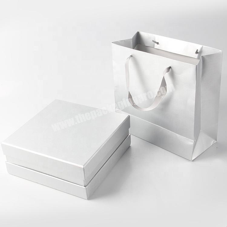 Wholesale hot glossy white jewelry paper bags for wedding dress