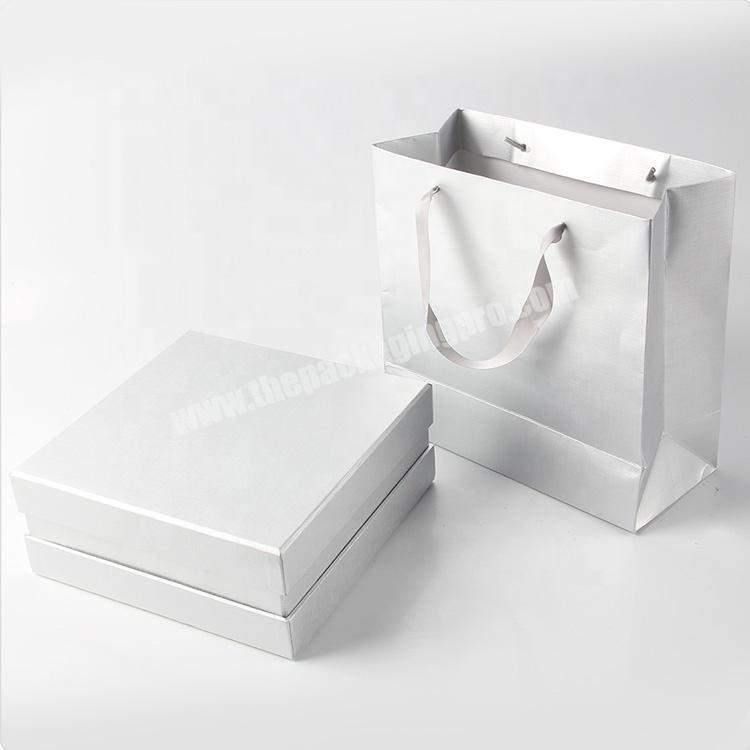 Factory hot glossy white jewelry paper bags for wedding dress