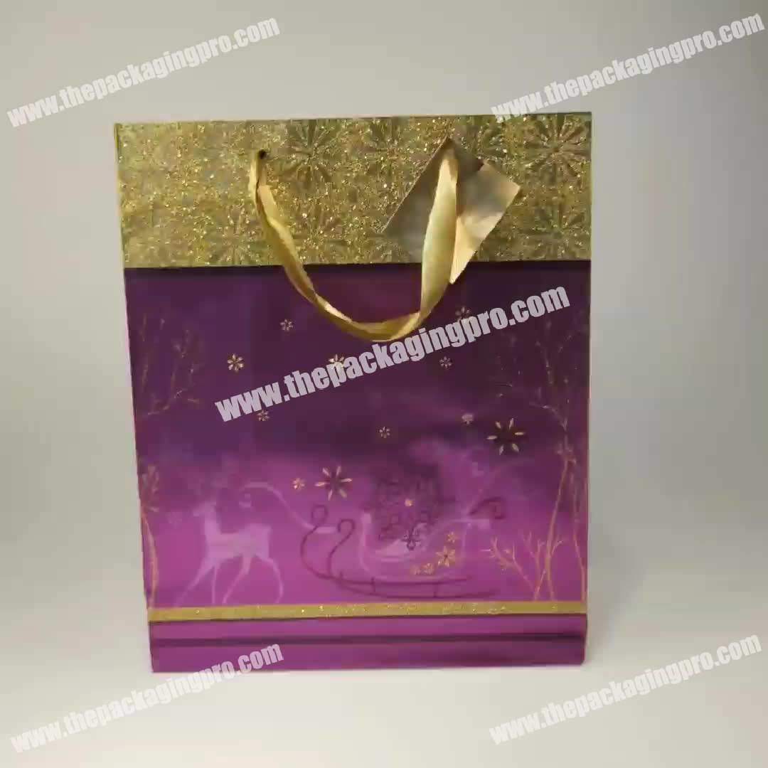Luxury christmas gift foil paper bags packaging bag with ribbon handle