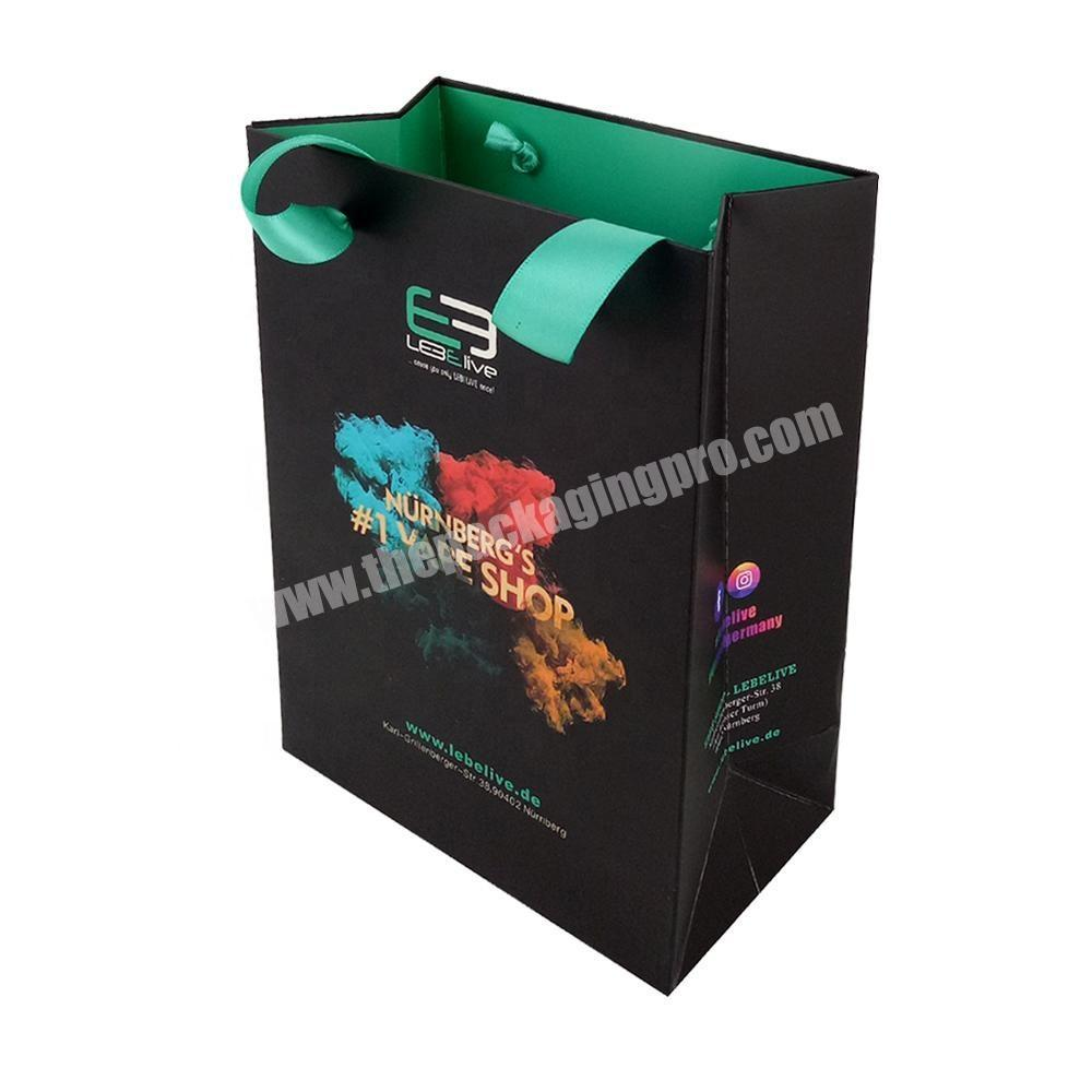 Luxury paper shopping bag with ribbon handle for shopping mall