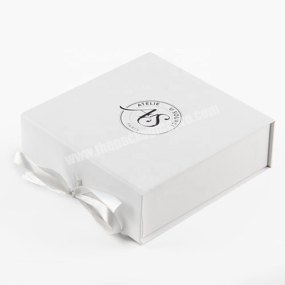 White cosmetic product package paper cardboard box with ribbon