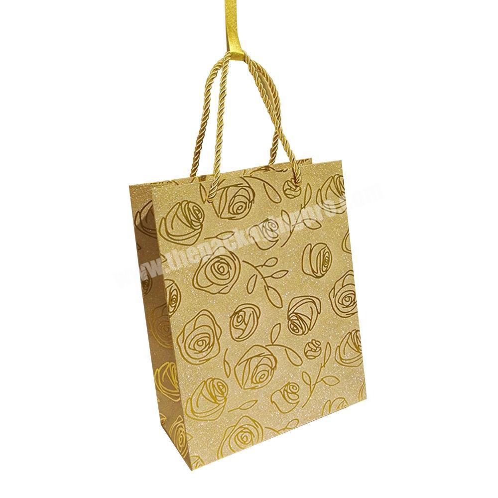 Wholesale custom shopping gift wrapping glitter paper bag with rope handles