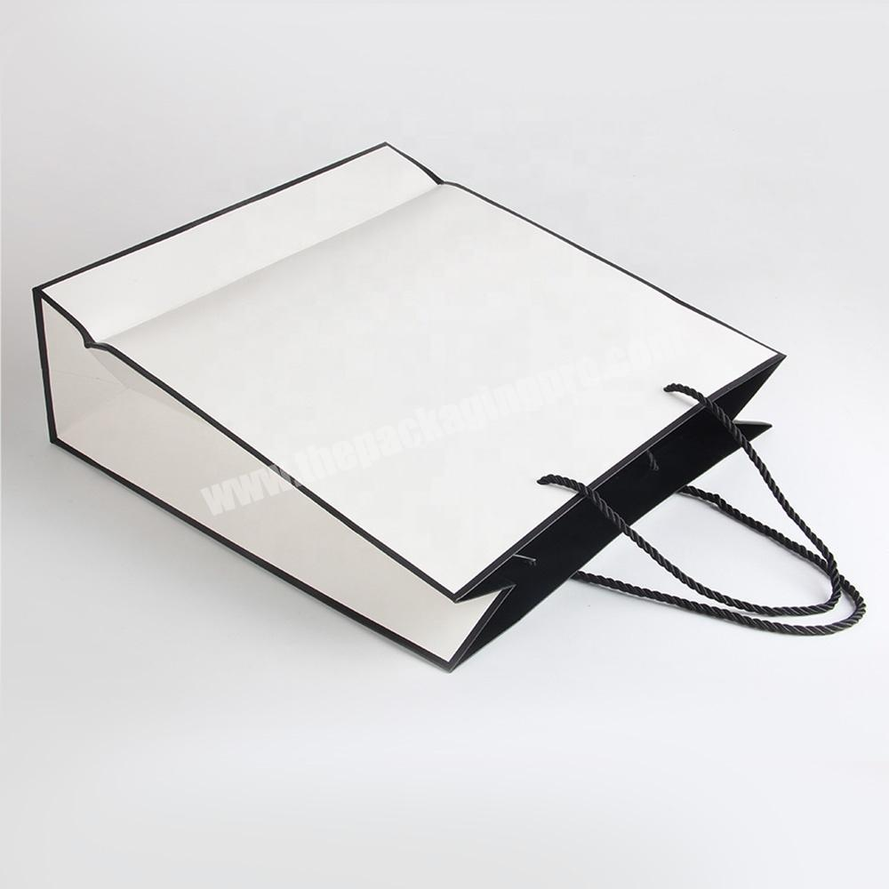 Wholesale wholesale white paper carrier bags packaging bag without logo